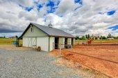 Horse farm land with barn. — Stock Photo