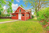 Small coutnryside house exterior in bright red color — Stock Photo