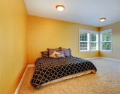 Bedroom interior in bright yellow color — Stok fotoğraf