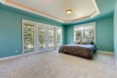 Master bedroom in turquoise color — Stock Photo