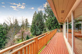 Large furnished deck with view of grennery. — Stock Photo