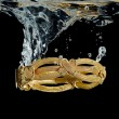 Bracelet in water — Stock Photo #66747809