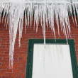 Long Icicles on a Gutter — Stock Photo #58819565