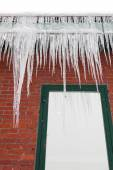 Long Icicles on a Gutter — Stock Photo