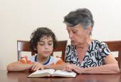 Hispanic Family Studying the Holy Bible — Stock Photo