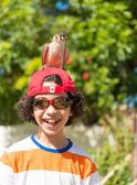 Child playing with bird — Stock Photo