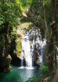Tropical countryside with waterfall — Stock Photo