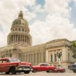 Transportation and The Capitol or El Capitolio in Havana — Stock Photo #61101459