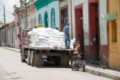 Unloading a truck of flour — Stock Photo