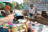 Street seller of items nationally produced — Stock Photo