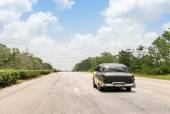 Old car driving on a road in Cuba — Foto de Stock