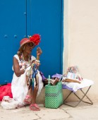 Woman selling souvenirs — Stock Photo