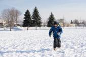 Child Boy Running in an Open Field of Snow — Stock Photo