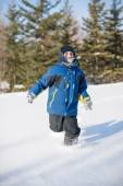 Child Boy Running in the Beautiful White Snow — Stock Photo