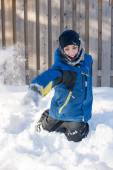 Child Playing Throwing Snow in Winter — Stock Photo