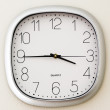 Wall Clock in an office, time is quarter to four — Stock Photo #69353533