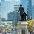 Back view of statue of John A. MacDonald looking at Downtown Core — Stock Photo #75578915