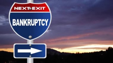 Bankruptcy road sign with flowing clouds — Stock Video