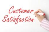 Writing customer satisfaction word on whiteboard  — Zdjęcie stockowe
