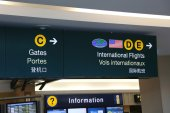 Direction sign inside YVR airport — Stock Photo