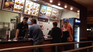 People ordering food inside KFC store — Stock Video