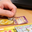 ������, ������: Scratching lottery tickets with computer background