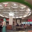 People enjoying dinner in modern mall food court cafeteria with wide angle camera shot — Stock Video #56856877