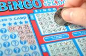 Scratching lottery ticket called bingo. — Stock Photo