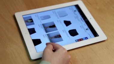 Close up woman shopping new skirt on ipad display — Stock Video
