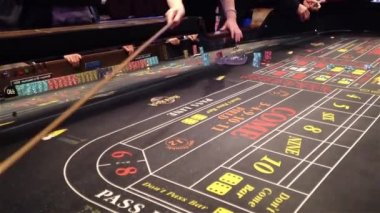 Dice rolling across a craps table — Stock Video