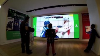 People playing hockey game for Microsoft store demonstrates in Burnaby BC Canada. — Stock Video