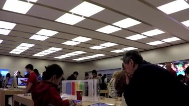 Motion of people buying new iphone inside Apple store with wide angle camera shot — Stock Video