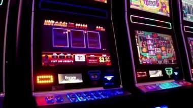 Close up slot machine inside Hard Rock Casino in Coquitlam BC Canada with wide angle shot. — Stock Video