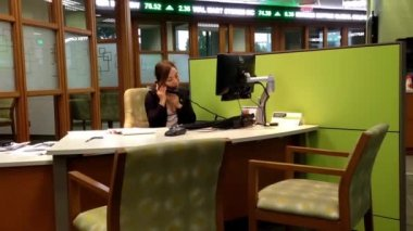 Manager answering phone for customer inquiry inside TD Bank — Stock Video