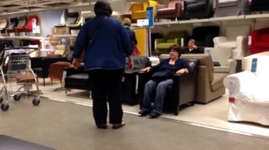 Motion of people shopping their furniture inside Ikea store. — ストックビデオ