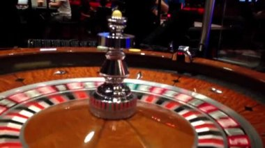 A shot of a casino roulette in motion inside starlight casino. — Stock Video