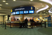 People asking some information insdie the YVR airport in Vancouver BC Canada.  — Stock Photo