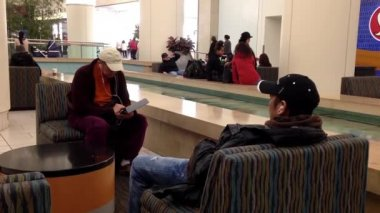 Close up man listening music at rest area beside fountain — Vídeo stock