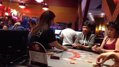 People playing black jack table game inside starlight casino. — Stock Video