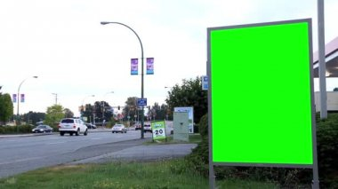 Green billboard for your ad on the street in Port Coquitlam BC Canada. — Stock Video