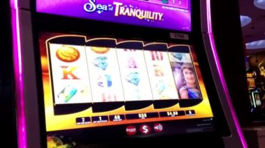 Close up people playing slot machine inside Hard Rock Casino in Coquitlam BC Canada — Stock Video