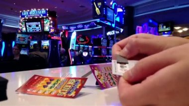 One side of woman playing pull tap game inside Hard Rock Casino in Coquitlam BC Canada — Vídeo de Stock