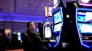 One side of people playing slot machine inside Hard Rock Casino in Coquitlam BC Canada — Vídeo de Stock