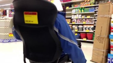 Man trying new office chair inside London Drugs store — Stock Video