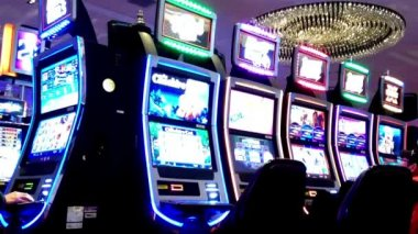 Close up people playing slot machine inside Hard Rock Casino in Coquitlam BC Canada. — Stock Video