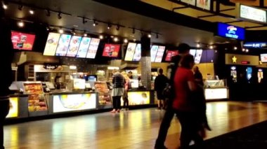 People line up for buying food at cinema — Stock Video
