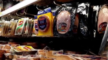 Man selecting ham in grocery store at dairy and forzen department. — Stock Video