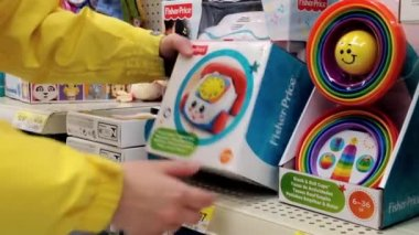 Woman choosing toy for child inside Walmart store in Burnaby BC Canada. — Stock Video