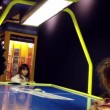Closeup two young grils playing air hockey table game — Stock Video #69137069