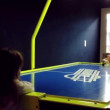 Closeup two young grils playing air hockey table game — Stock Video #69137207
